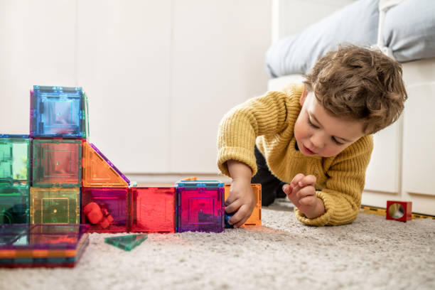 Boy playing with building Blocks stock photo