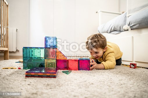 istock Boy playing with building Blocks 1126346692