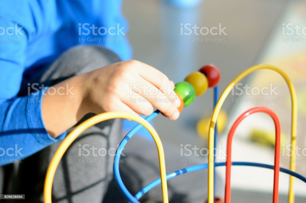 Boy Playing with Education Toys stock photo