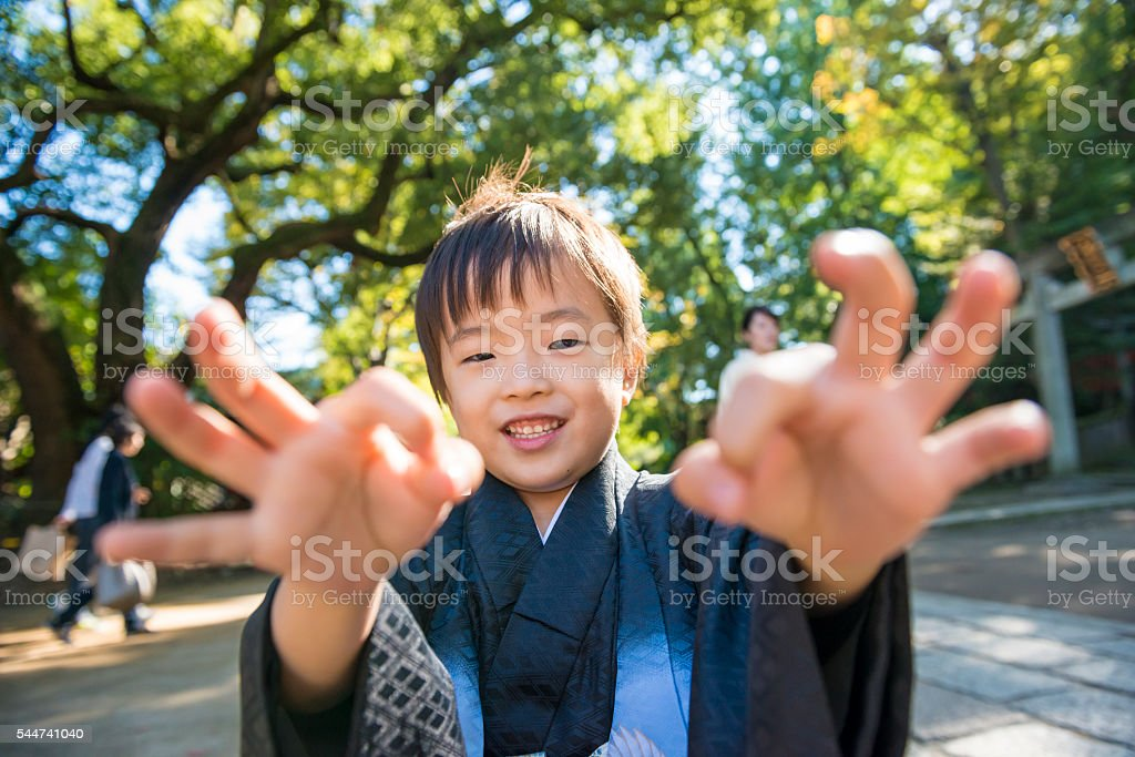 Boy playing with his fingers. stock photo