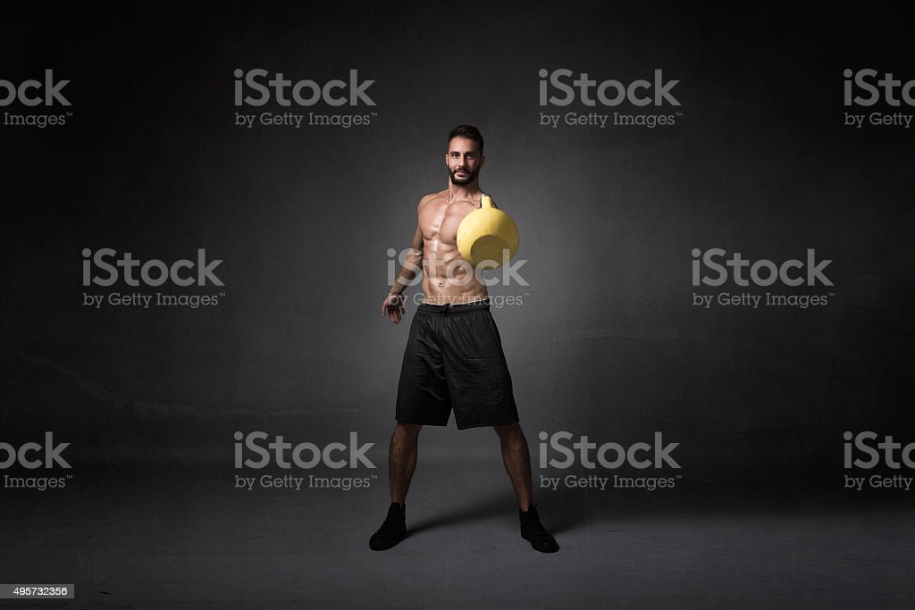 boy playing with kettlebell stock photo