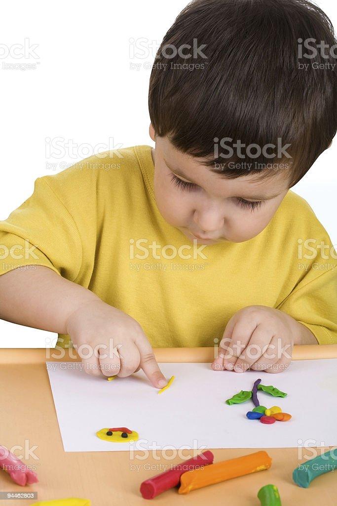 boy playing with plasticine royalty-free stock photo
