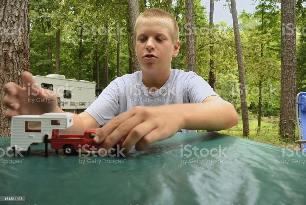 Boy playing with rv toy in campground royalty-free stock photo