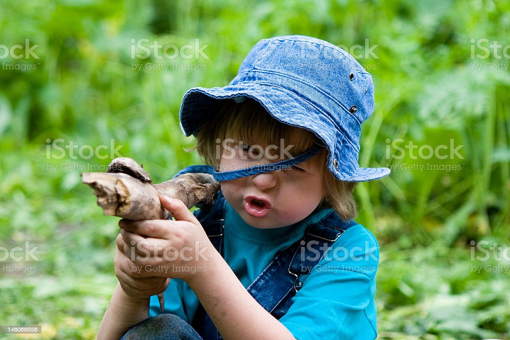 Boy playing with stick like gun (series Children) stock photo