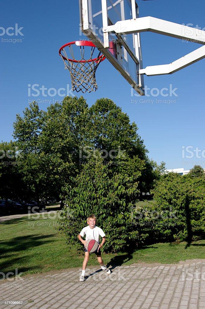 Boy plays basketball royalty-free stock photo