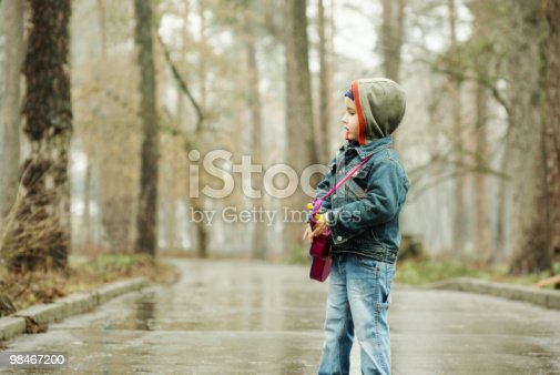 Boy Plays Guitar In Rainy Park Stock Photo & More Pictures of Alley