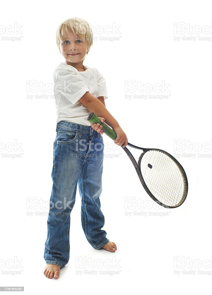 Boy plays tennis royalty-free stock photo