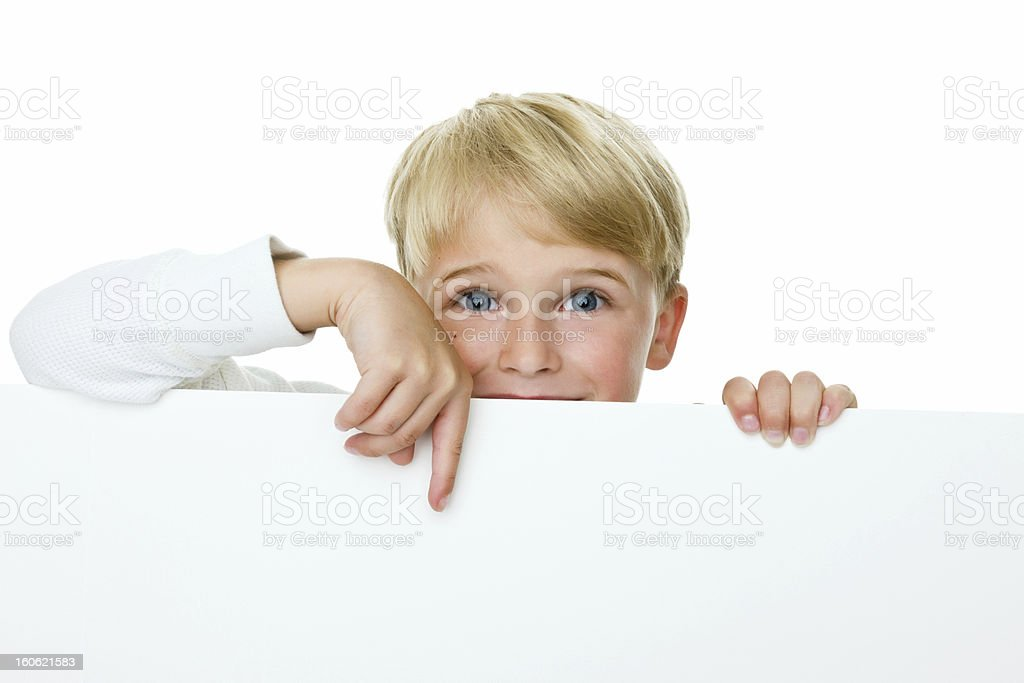 Boy pointing to copy space royalty-free stock photo