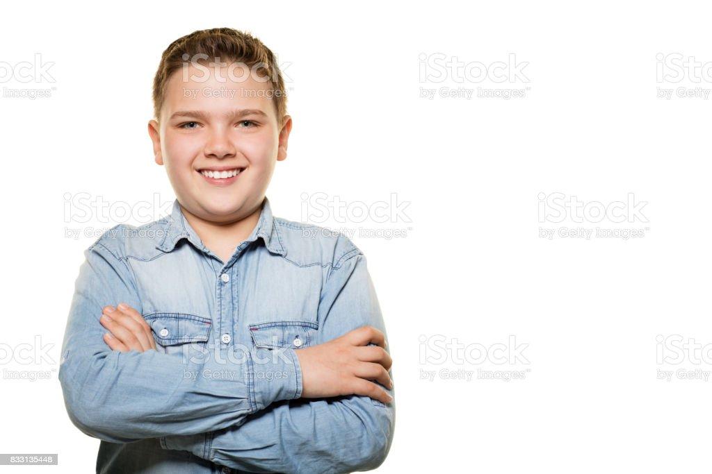 Boy posing on white background. stock photo
