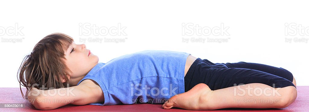 Boy practice yoga stock photo