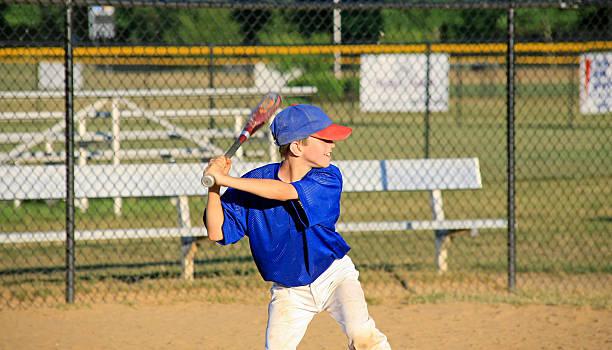 Boy Practicing Baseball stock photo