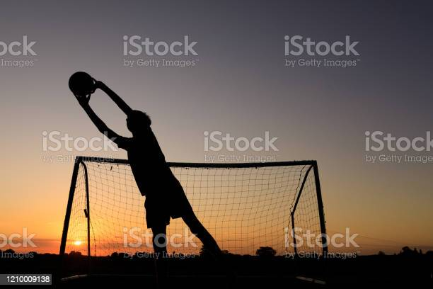 Boy practicing soccer skills at sunset picture id1210009138?b=1&k=6&m=1210009138&s=612x612&h=bbdvz04 7a5eceyvw18deizgcqgdgja5sjmtayki1gu=
