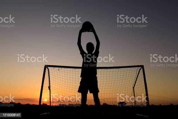Boy practicing soccer skills at sunset picture id1210009141?b=1&k=6&m=1210009141&s=612x612&h=yzyyu8 dvd6irtqaybphq7hztzzw1la9qpiphxaae0w=