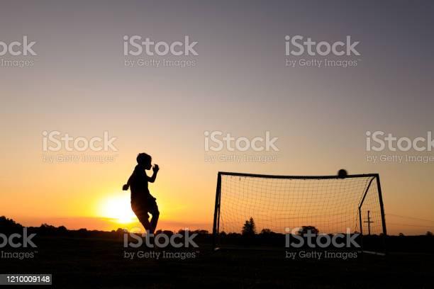 Boy practicing soccer skills at sunset picture id1210009148?b=1&k=6&m=1210009148&s=612x612&h=urbwap5foxuxe5mpiz2zuodnx6b5qgjfj3ifnh7zytk=