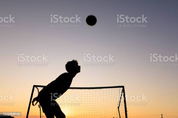 Boy practicing soccer skills at sunset picture id1210009152?b=1&k=6&m=1210009152&s=612x612&h= ct  jmr6lzbre cy9gj6nr96zdyrvw3iquxb psk50=