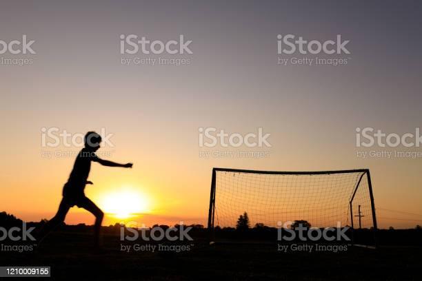 Boy practicing soccer skills at sunset picture id1210009155?b=1&k=6&m=1210009155&s=612x612&h=s68dfmt5eqfsoiqgsdo6d4gvad6frrviv0wadsrier8=