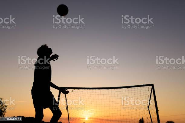 Boy practicing soccer skills at sunset picture id1210009171?b=1&k=6&m=1210009171&s=612x612&h=8vkyvbjuswmk h3pu46rgdqkl5yq8x7xtt3oubdgysa=