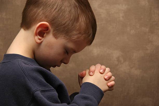 Boy praying - color Boy praying Amen stock pictures, royalty-free photos & images