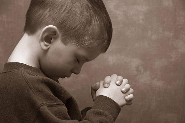 Boy Praying - Landscape Boy praying Amen stock pictures, royalty-free photos & images