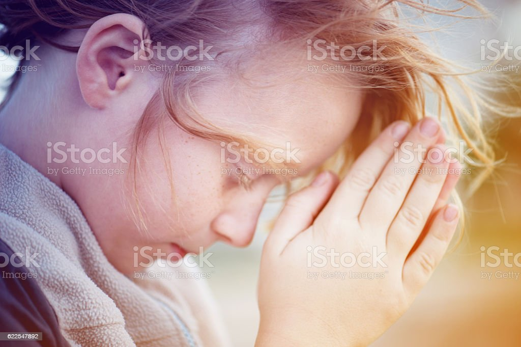 boy praying to God. stock photo