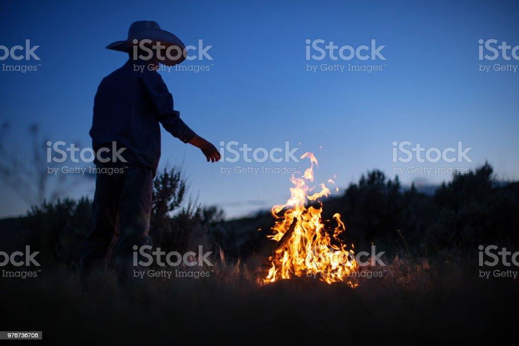 Boy preparing campfire