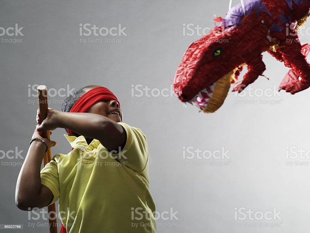 Boy preparing to hit pinata royalty-free stock photo