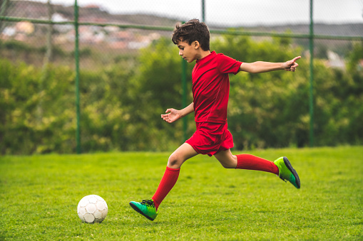 Boy preparing to kick the ball