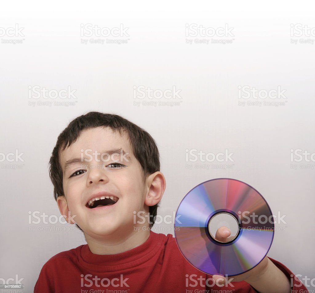 Boy presenting a compact disc royalty-free stock photo