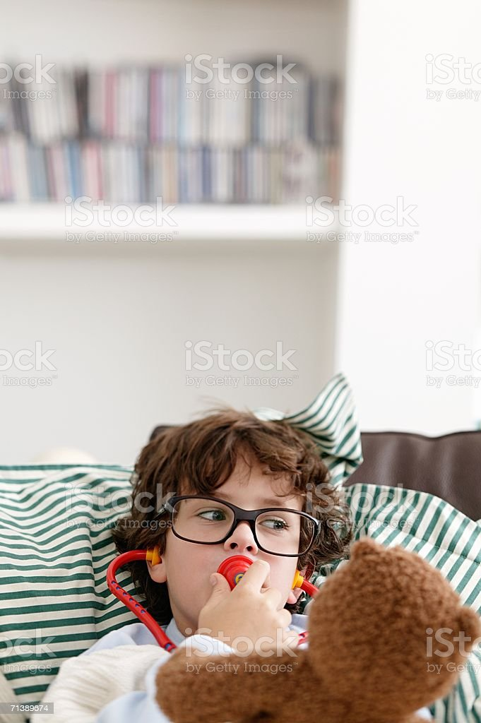 Boy pretending to be a doctor royalty-free stock photo