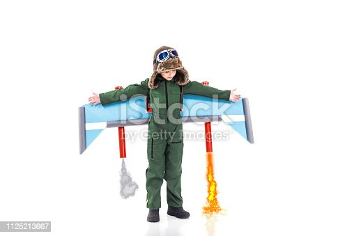 620402800istockphoto Boy pretending to fly with jet 1125213667