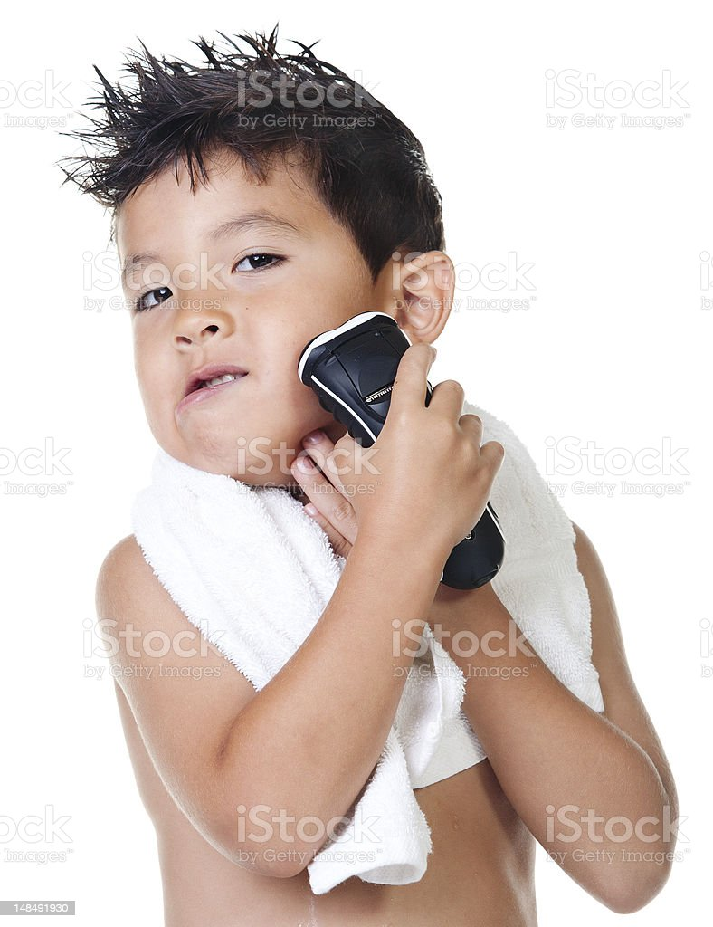 Boy pretends to shave. stock photo