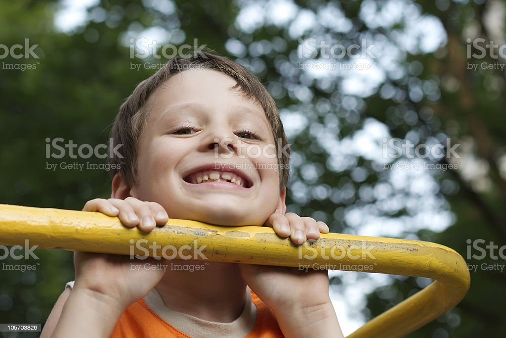Boy pulling himself up royalty-free stock photo