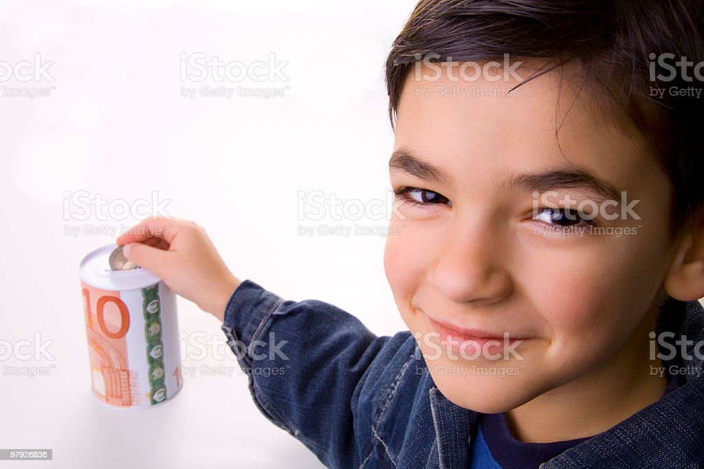 Boy putting coin royalty-free stock photo