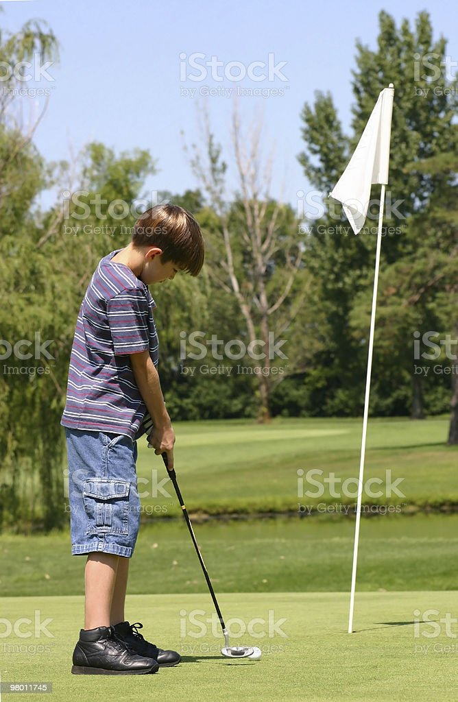 Boy Putting royalty free stockfoto