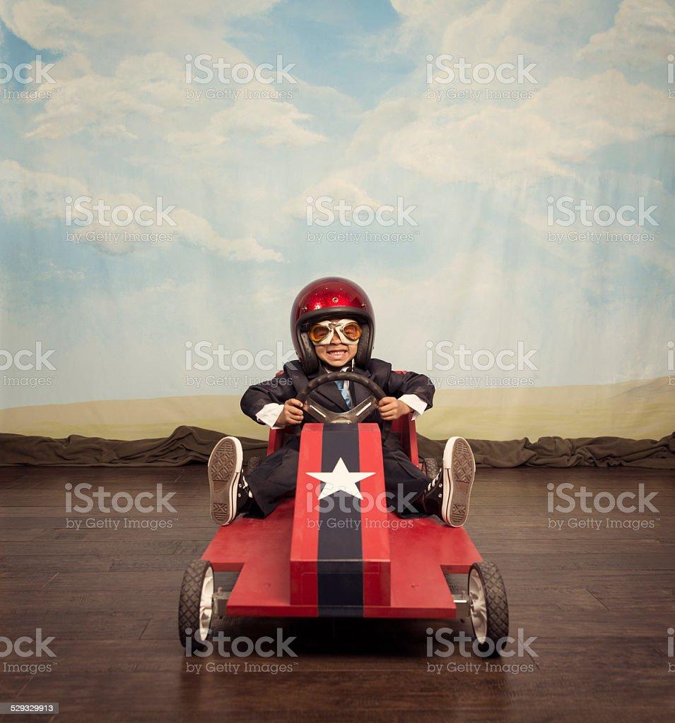 Boy racer ready for speedy business stock photo