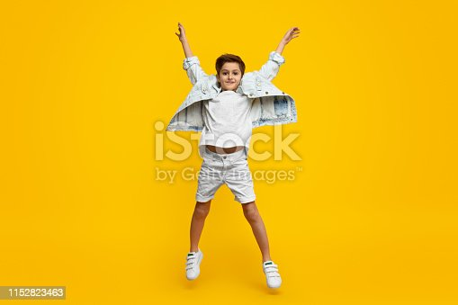 istock Boy raising hands and jumping 1152823463