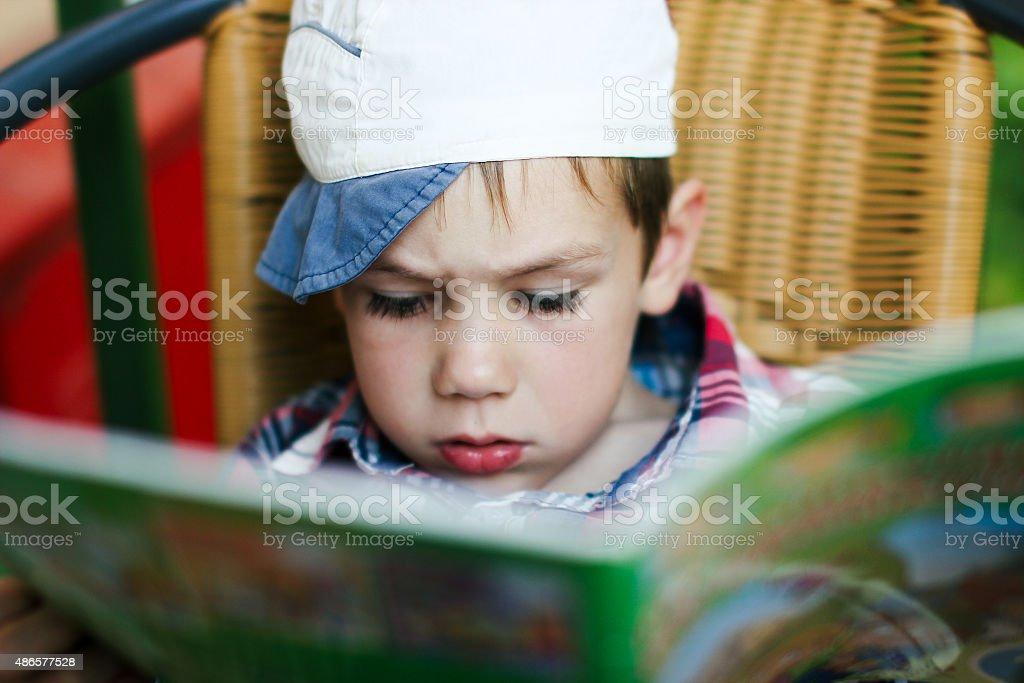 boy reading a magazine stock photo