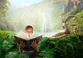 Boy reading a wonderful fairy-tale story.