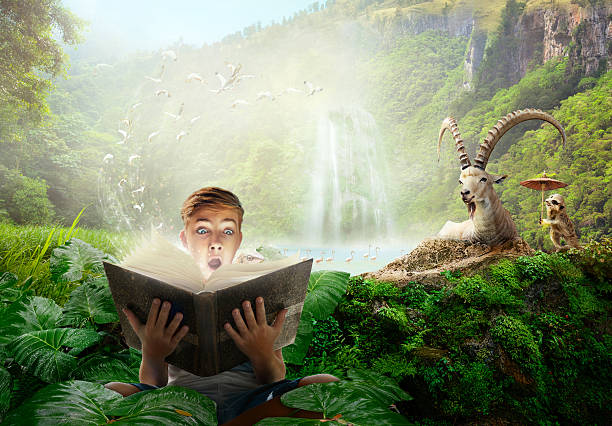 Boy reading a wonderful fairy-tale story. stock photo