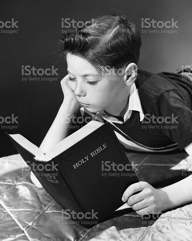 Boy reading Bible royalty-free stock photo