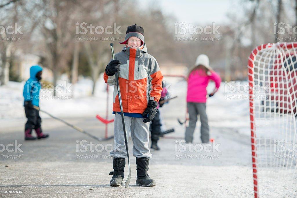 Boy Ready to Play Street Hockey stock photo