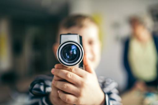 Boy records with vintage camera