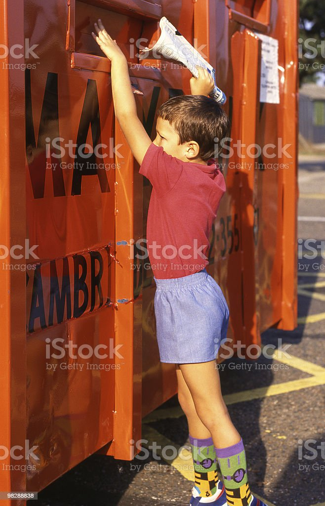 Boy recycling waste paper royalty-free stock photo
