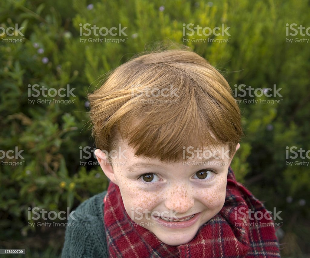 Boy Redhead Freckle Face, Smiling Christmas Child & Mischief Maker royalty-free stock photo