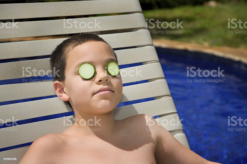 Boy relaxing by the pool royalty-free stock photo