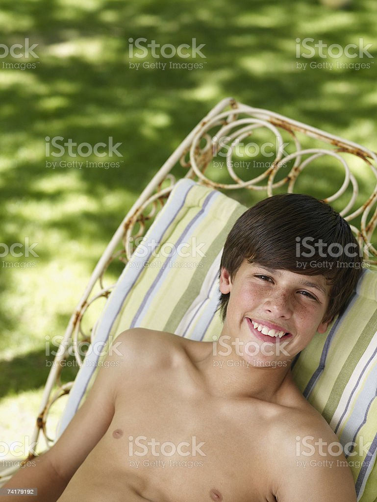 Boy relaxing outdoors in summer smiling royalty-free stock photo
