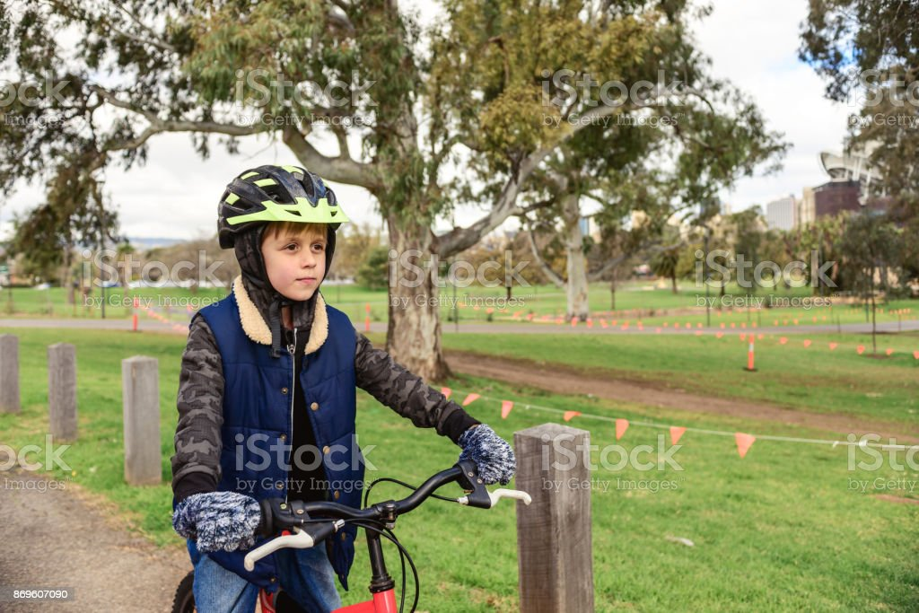 Boy riding bicycle in Adelaide CBD stock photo