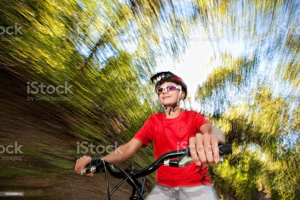 Boy Riding Bike on Mountain Trail royalty-free stock photo