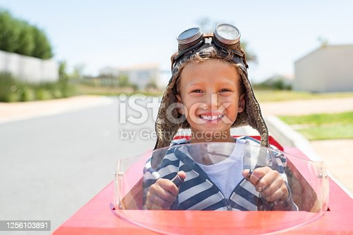 1035136022 istock photo Boy riding go-kart on street 1256103891