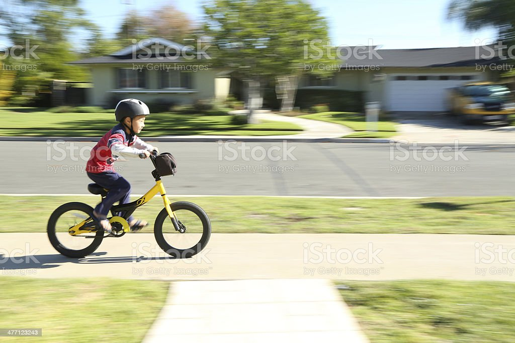 Boy riding his bike fast in motion blur stock photo